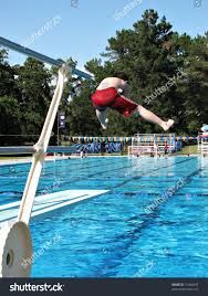 public swimming pools with diving boards. Boy Doing A Funny Jump Off The Diving Board At Public Swimming Pool. Pools With Boards