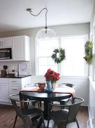 light fixture over kitchen table swag light fixture glass bowl after 2 enchanting sphere chandelier light