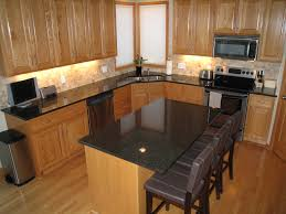 Amazing black Dark Granite Countertops With Light Cabinets and grey stools  on wood floor and brown