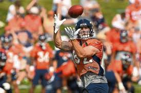 tight end jeff heuerman pulls in a pass tuesday during broncos training camp at uchealth training