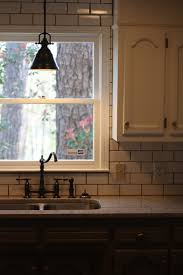 over kitchen sink lighting. Classic Pendant Lamp As Kitchen Sink Light Fixture White Subway Tiles Backsplash A Glass Window With Over Lighting N