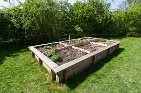 Amazing wooden garden planters ideas try Built Raisedgardenbed Old Farmers Almanac How To Build Raised Garden Bed Planning Building And Planting
