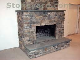 new england fieldstone ledgestone and ashlar veneer fireplace br with bluestone hearth