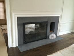 the fireplace surrounds are flamed finish absolute black granite and granite fireplace surround