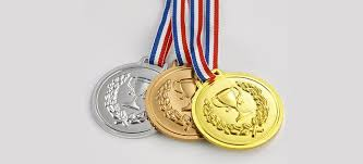 silver bronze and gold medals on red blue and white chains