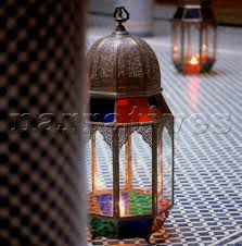 traditional stained glass candle lanterns on a mosaic tiled floor in the hotel riad myra in