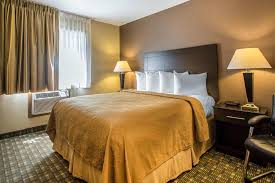 a bed or beds in a room at quality inn suites decorah