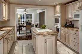 whitewashed kitchen cabinets so get wood look but doesn't clash with wood  floor