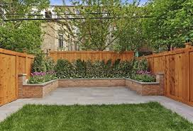 wood fence backyard. Perfect Fence This Finished Fence Wraps Around A Brick Flowerbed And Wood Fence Backyard
