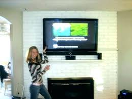 how to hide wires over brick fireplace wall mounted hiding tv cords on stone
