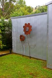 Love the metal flowers. Just imagine these surrounded by greenery other  than just grass.