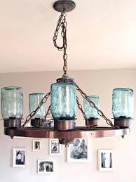 wagon wheel light fixture with blue mason jars jar chandelier