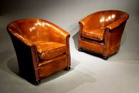a stylish pair of 1920 s leather tub chairs