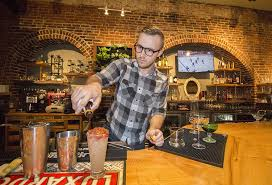 to enlarge bartender tai nalewajkó mixes drinks behind the bar photo by mabel suen