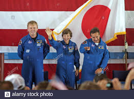 Discovery Astronauts Andy Thomas of Australia, Wendy Lawrence and Charlie  Camarda react to crowd at a