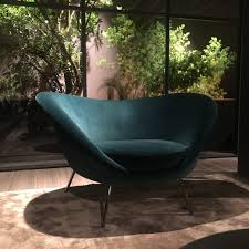 which makes the armchair particularly enveloping and comfortable today velvets are often used in interior design because the new composition of the