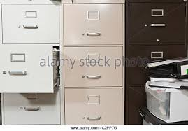 messy file cabinet. Funky File Cabinets With Binders Boxes. - Stock Image Messy Cabinet