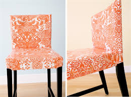 removable oilcloth chair covers maybe make some for the bench seating at the table too