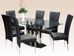 affordable glass dining room table with 4 black leather dining chairs