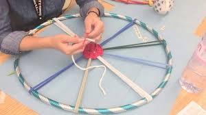 a messy art room hula hoop weaving demonstration