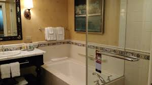green valley ranch resort and spa tub with glass doors walk in shower