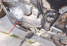 noob question neutral safety switch xjbikes yamaha xj and i m pretty sure the switch isn t behind the cover yamaha on it right any one got a pic they can post showing it s location thanks guys