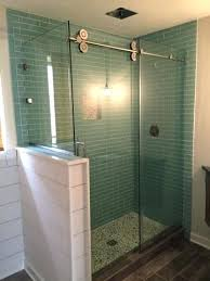 half wall shower glass barn door with half wall coloured glass shower wall panels