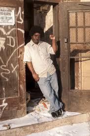 a black man standing the door