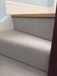 grey carpet bedroom. grey carpet to stairs in private residence south london bedroom e