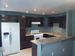 kitchens with white appliances and dark cabinets photo 3