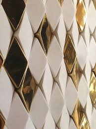 ceramic tiles design. Fine Design Gold Tiles The Columns Are Composed Of Ceramic Tiles In Both Matte White  And High Gloss Gold Finish Angled Varying Directions To Show Reflect Shimmer In Ceramic Tiles Design O