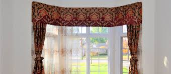 this bay window utilizes our double curtain track with valance for hanging sheers and curtain