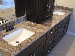 chocolate bordeaux granite on cherry espresso cabinets modern bathroom
