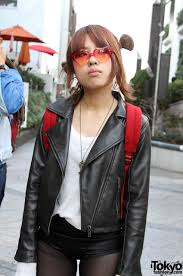 red hair in pig tails and leather jacket