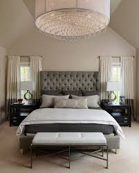 transitional bedroom with large chandelier