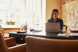 young woman working at the check in desk of a boutique hotel stock image