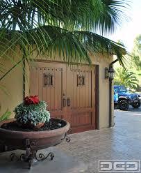 mediterranean carriage house style garage doors that swing open for pedestrians mediterranean granny