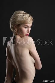 Portrait Of Beautiful Nude Short Hair Woman With Jewelry Accessories Naked Sexy Blonde Girl With Brush Earring Isolated Black Background Stock Photo