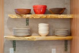 reclaimed wood floating shelves with dishes