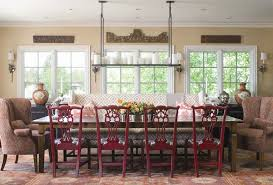 Eclectic Dining Room with Chandelier, Built-in bookshelf, Paisley Wing Back  Chair in
