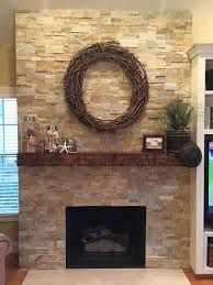 carr family fireplace wrapped in dry stacked stone veneers