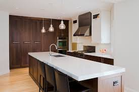 dark brown wooden kitchen cabinets and island having white from modern minimalist kitchen cabinet and contertop