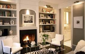 gorgeous built in bookshelves surrounding fireplace with sconce lighting
