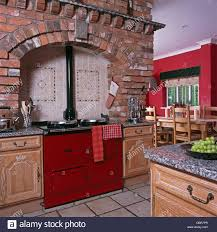 Red Brick Tiles Kitchen Exposed Brick Wall And Ceramic Wall Tiles Above Red Aga Oven In