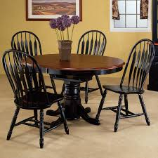 simple dining room decor using round dining table for 6 people plus wall decor ideas