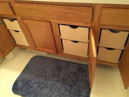cabinets with drawers. the bathroom cabinets were a mess. we decided to add pull out drawers. with drawers g
