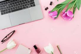 pink office desk. Office Desk With Laptop, Tulip Flowers, Cosmetics, Glasses And Pen On Pink Background