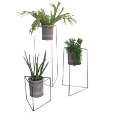 set of  industrial modern triangle planter stands with gray clay