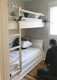 Making bunk beds Toddler Clamps Holding Diy Bunk Bed Ladder And Railings In Place Young House Love How To Make Diy Builtin Bunk Beds Young House Love