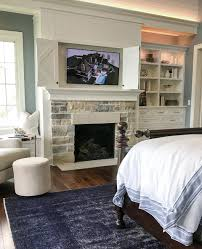 image decorate. Master Bedroom - Decorate Around The TV With Folding Barn Doors Close To Hide Them Image